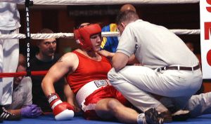CAMP LEJEUNE, N.C. - Super heavyweight, 1st Lt. Adam Rickenbach, is counted out in the second round after his bout with Sgt. Ruebben Woodruff Nov. 20. Rickenbach and fellow Marines are competing in the annual U.S. Marine Corps Boxing Team preliminaries here this week (Official U.S. Marine Corps photo by Sgt. Allan J. Grdovich).